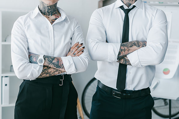 modern office etiquette tattoos piercings foul language non-traditional hair color