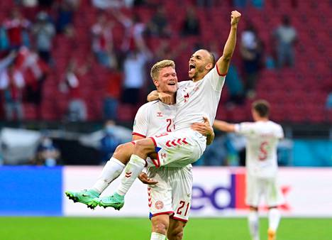 Andreas Cornelius grabbed his goal in the arms of the celebratory Martin Braithwaite in the final moments of the Wales match in Amsterdam on 26 June.