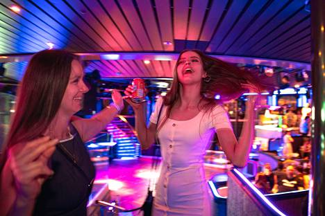 Cousins Päivi (left) and Emma Lainti got excited to dance, even though the nightclub's actual dance floor was closed.