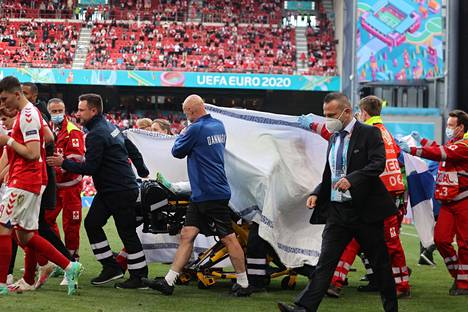 Christian Eriksen is transported off the field after a serious illness.