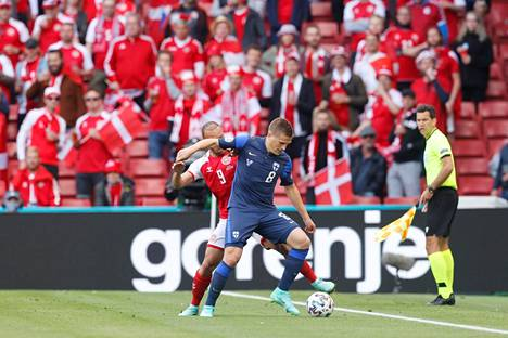 Martin Braithwaite fighting for the ball with Robin Lodi of Finland at the European Championships.