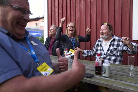 """Kati Paajanen, a basic Finn from Vantaa, is celebrating her vote.  At this point, there were 62 of them. """"Dad would be proud if he lived"""".  Jouni Kapanen (left), Tapani Sundell and Jarkko Jutila celebrated."""