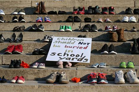 """""""Children shouldn't be buried in the school yard,"""" read a sign commemorating indigenous children who died in Canadian boarding schools."""
