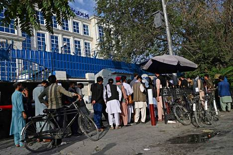 Kabul residents queued at an ATM on Saturday.