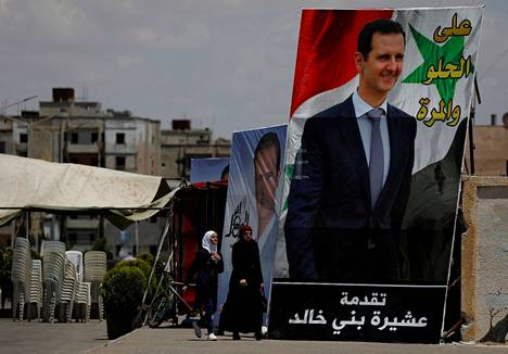 A poster by Syrian President Bashar al-Assad dominated the street scene in al-Waer, Homs, on May 23rd.  Al-Assad was elected for the fourth seven-year term in a May 26 election.