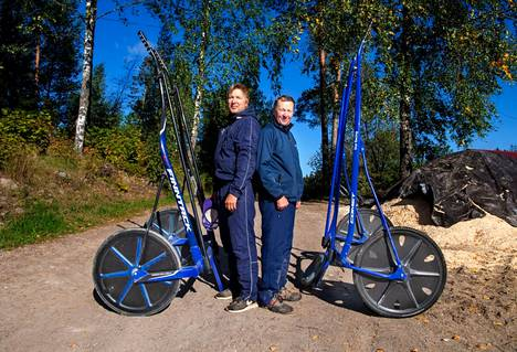 Hannu-Pekka and Pekka Korpi (right) train horses in the same stable area in Vihti.  Equipment such as racing carts are available to both.