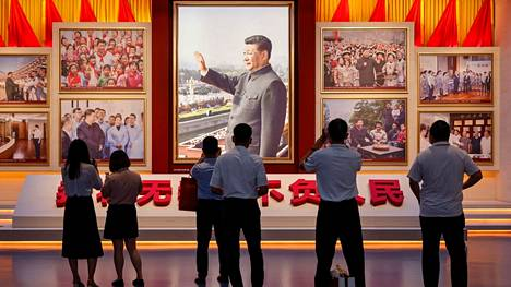 People looked at a picture of Chinese President Xi Jinping at the Chinese Communist Party Museum on June 25th.  The museum opened in Beijing before the centenary of the party's founding.