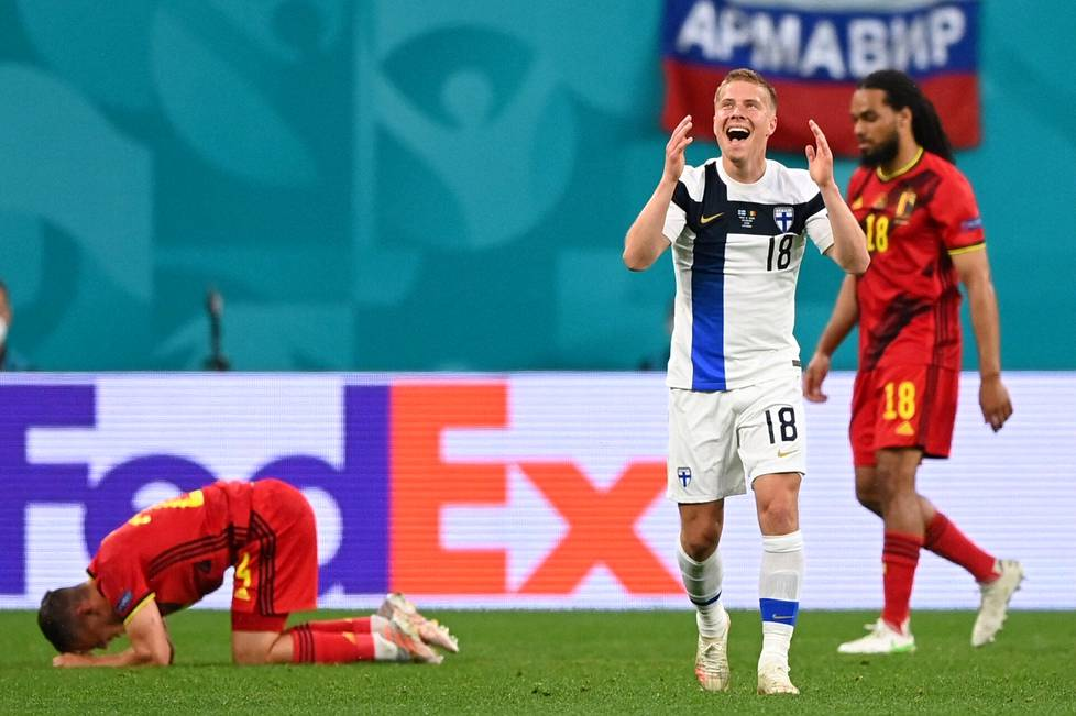 Jere Uronen reacted with astonishment after the referee whistled a foul for him in a duel against Leandro Trossard of Belgium (left).