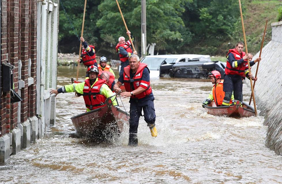 Members of the Austrian rescue team use boats in the floodplain of Pepinster, Belgium.