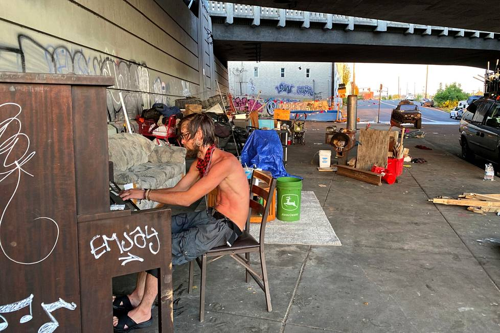 Tyson Morlock played the piano under a freeway bridge near a swimming pool in Portland on Tuesday.