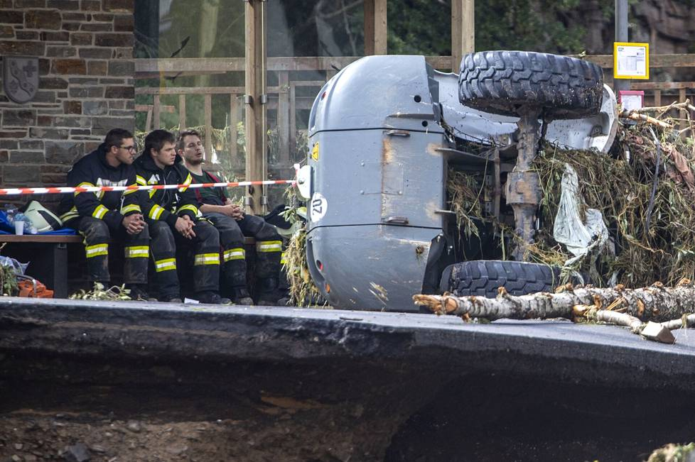 After the storm and floods, rescue workers took a break on a bench in a village in the Ahrweiler area of Germany.