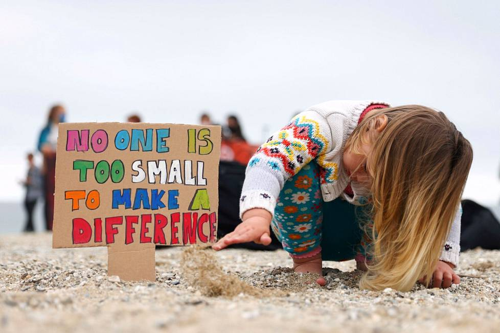 The little girl was playing on the beach during a climate activist demonstration in Fallmouth near St. Ives.