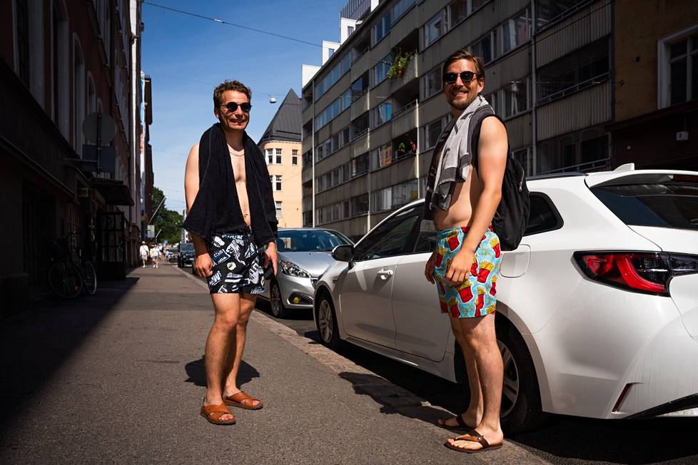 """Matti Melander (left) and Rasmus Blomqvist had gone swimming in Eiranranta.  The news of the possible end of the heat did not delight them, and Melander said he downright loved the heat.  """"A few cold days in between was pretty depressing downright,"""" Blomqvist added."""
