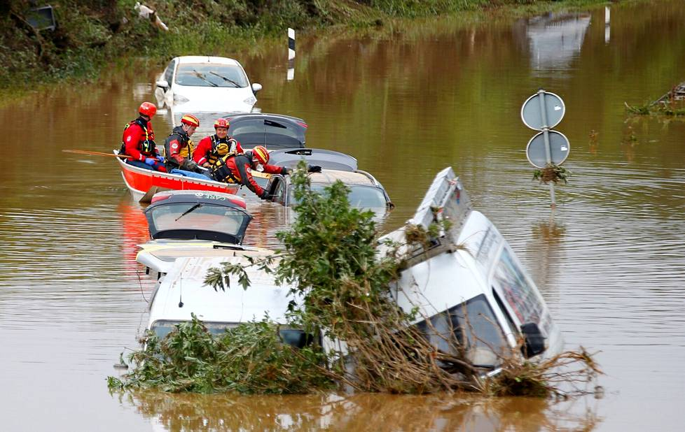 Rescue team inspects a car that has been flooded in Erftstadt, Germany