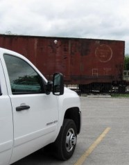 Photo by H.S. Cooper © Chevy and rail car (TX)
