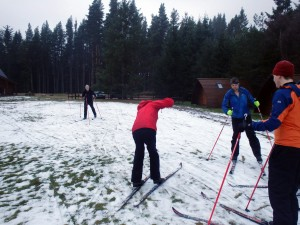 We tentatively try Nordic skis on for the first time just outside our lodge, and make a slalom course to test ourselves