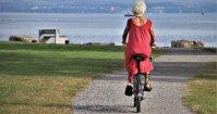 Image of woman riding bike
