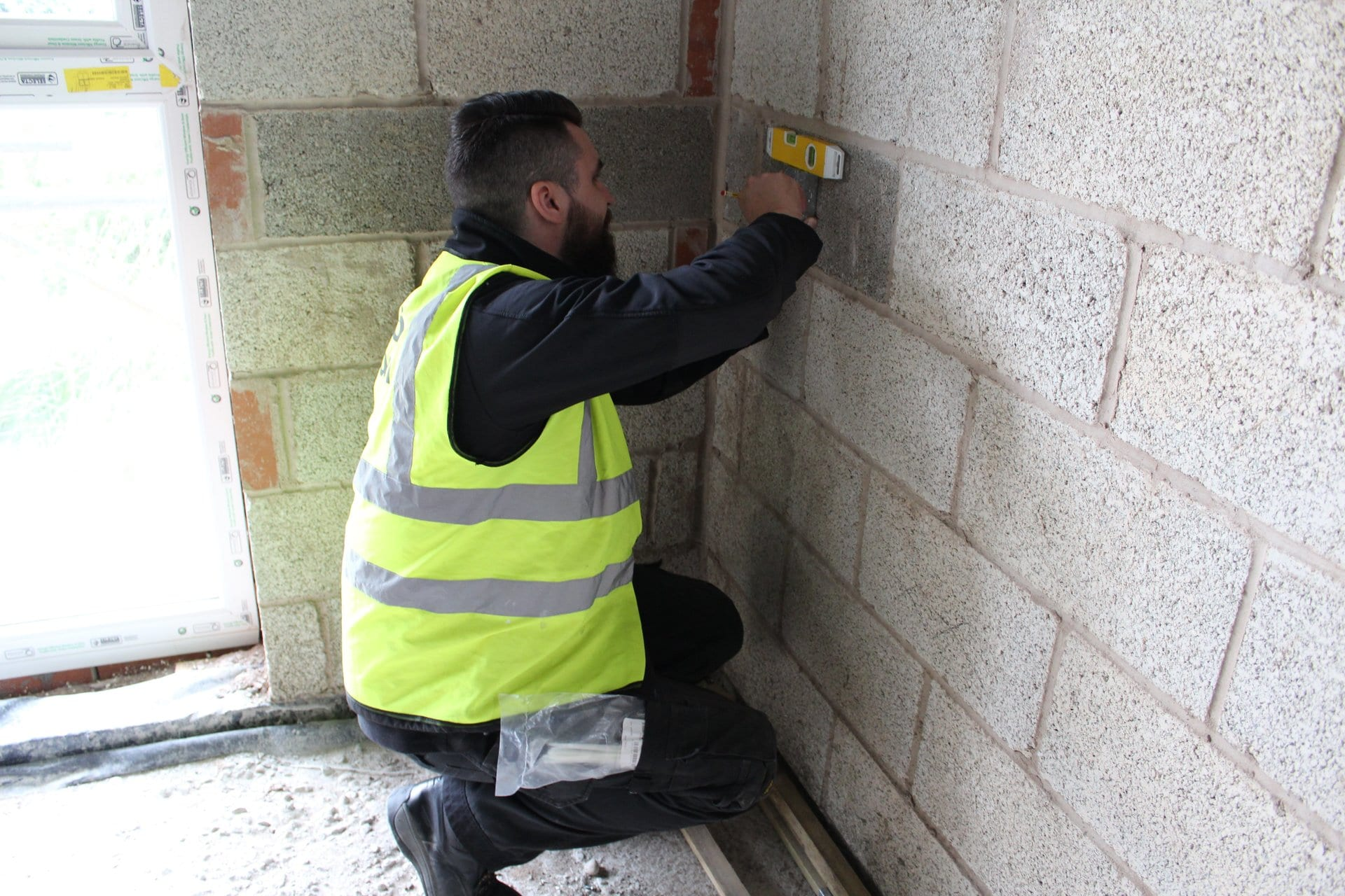 Full qualified HTS AV installation engineer preparing site for an installation