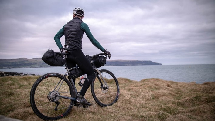A bikepacker overlooking the coast
