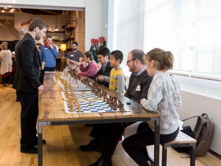 Some of the programming is untraditional, such as this chess tournament between a Grand Master and regular attendees.