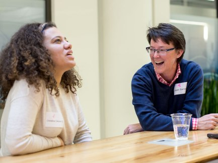 Christina Celuzza and Karen Barnes laugh at a creative programming idea.