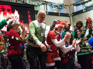 Tenants and community members network in ugly holiday sweaters