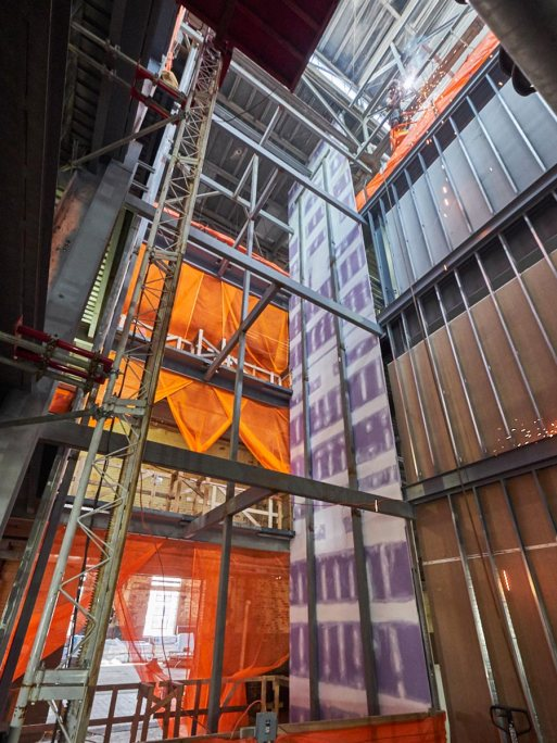 The elevator shaft reveals the floors the developers put in during construction.