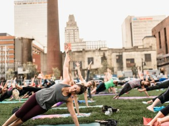 Schwab saw community yoga in Bryant Park and brought that experience back to Winston-Salem, picture from Sunset Salutations 2016