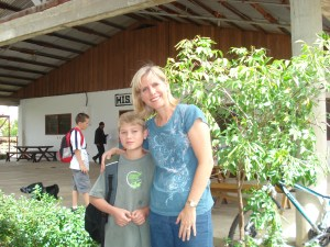 Linda Ringenberg and C.J., her son, in front of his school