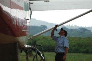 Mission Aviation Pilot, Jon Cadd inspects struts