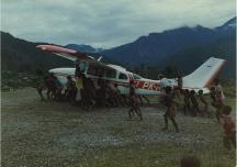 Airplane being pushed up the airstrip
