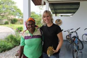 Linda and the woman she buys fruit from every week.