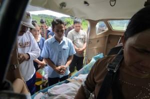 Praying for a passenger before an MAF medical evacuation flight—Tarakan, Indonesia. Photo by Tripp Flythe.