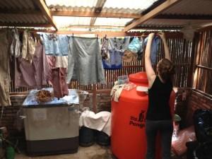Joy hanging laundry in Indonesia