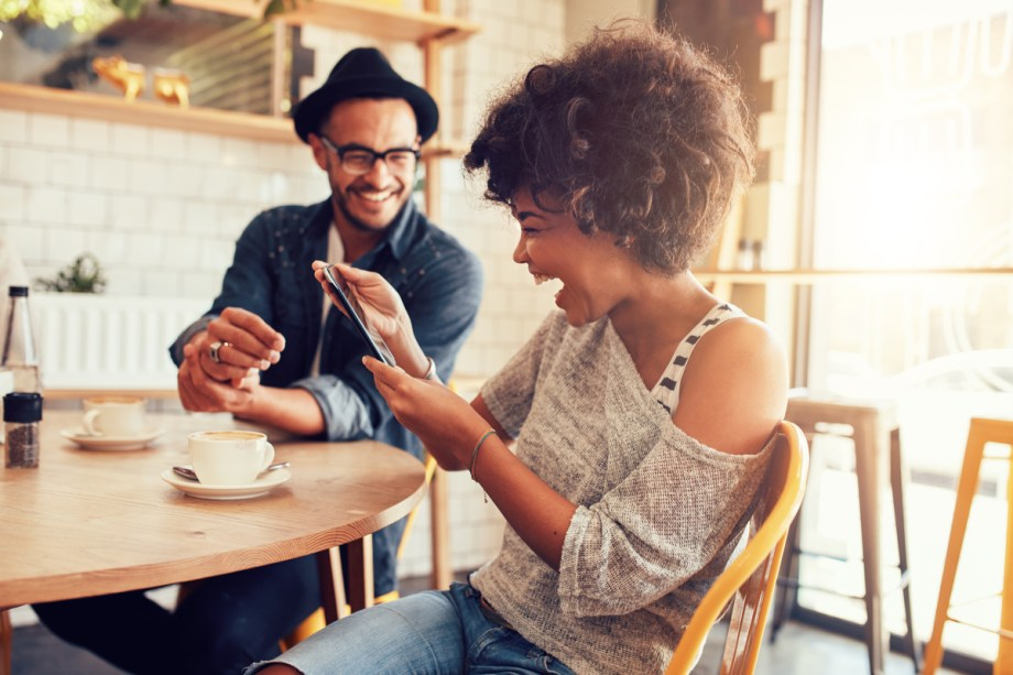 Best Food App shows lady and man looking at phone