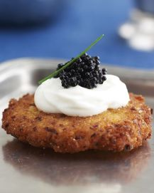 Latkes topped with sour cream and caviar pair well with champagne.
