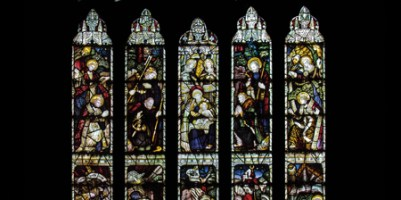 CE Kempe stained glass in the north transept, 1889. The nativity of Christ.