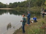 several boys fishing from shore