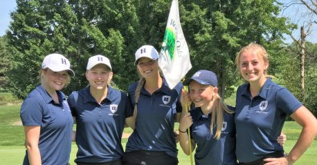 Five members of the girls golf team pose following their game.