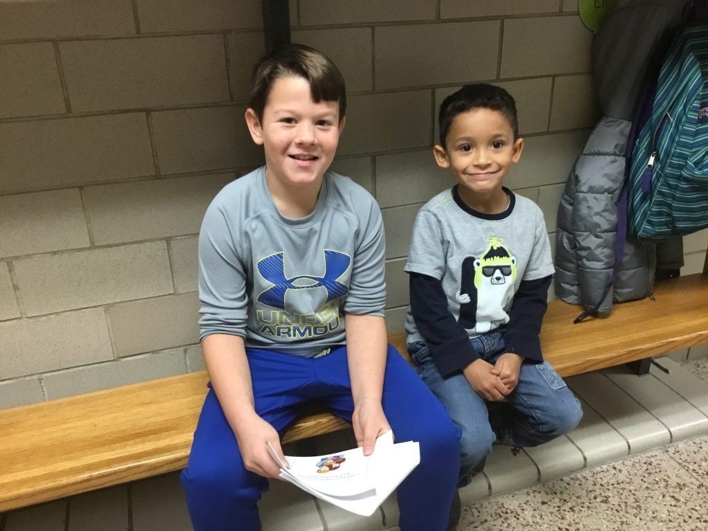 A peer help and student pair sitting together in the hallway at E.P. Rock.