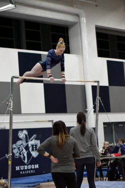 Hudson High School Gymnastics team member on the bar at meet on 1-4-19.
