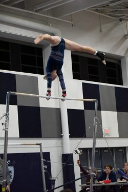 Hudson High School Gymnastics team member during bar routine at 1-4-19 meet.