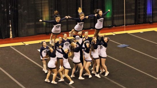 Cheer and stunt team competing at state.