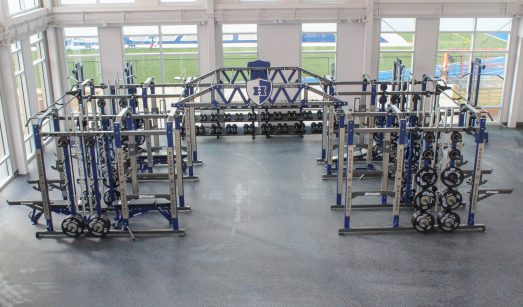 View of the HS lower fitness center weightlifting racks.