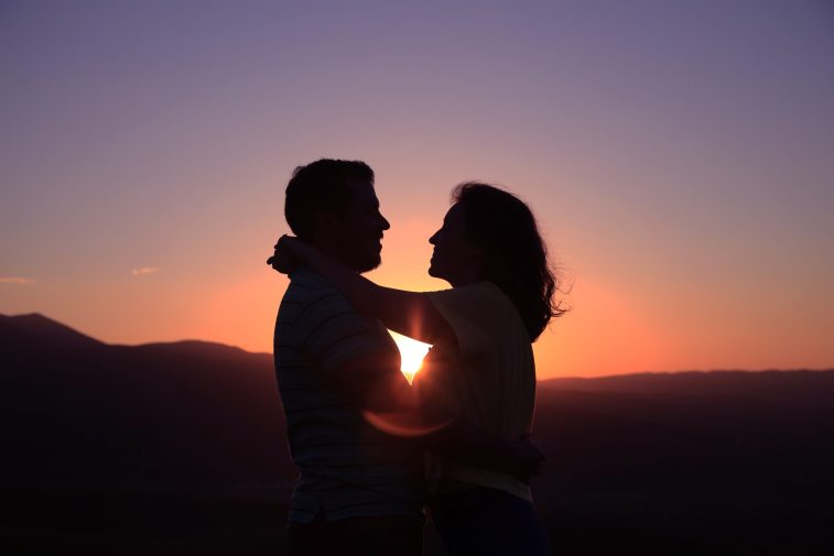 couple hugging in the sunset