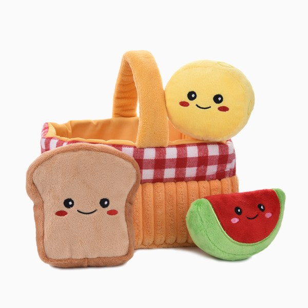 a orange basket with a scone, toast and watermelon slice dog toy