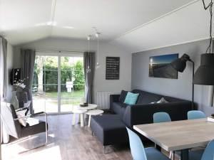 Huiskamer Chalet de Strandloper - Huisje huren op Texel