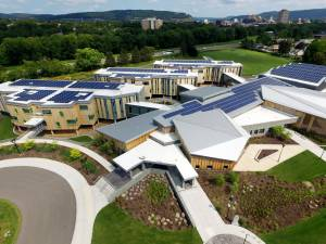 aerial view of a building with solar panels on the roof - aerial-view-of-a-building-with-solar-panels-on-the-roof