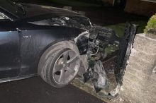 audi-wedged-into-garden-after-dramatic-crash-as-youths-'walk…