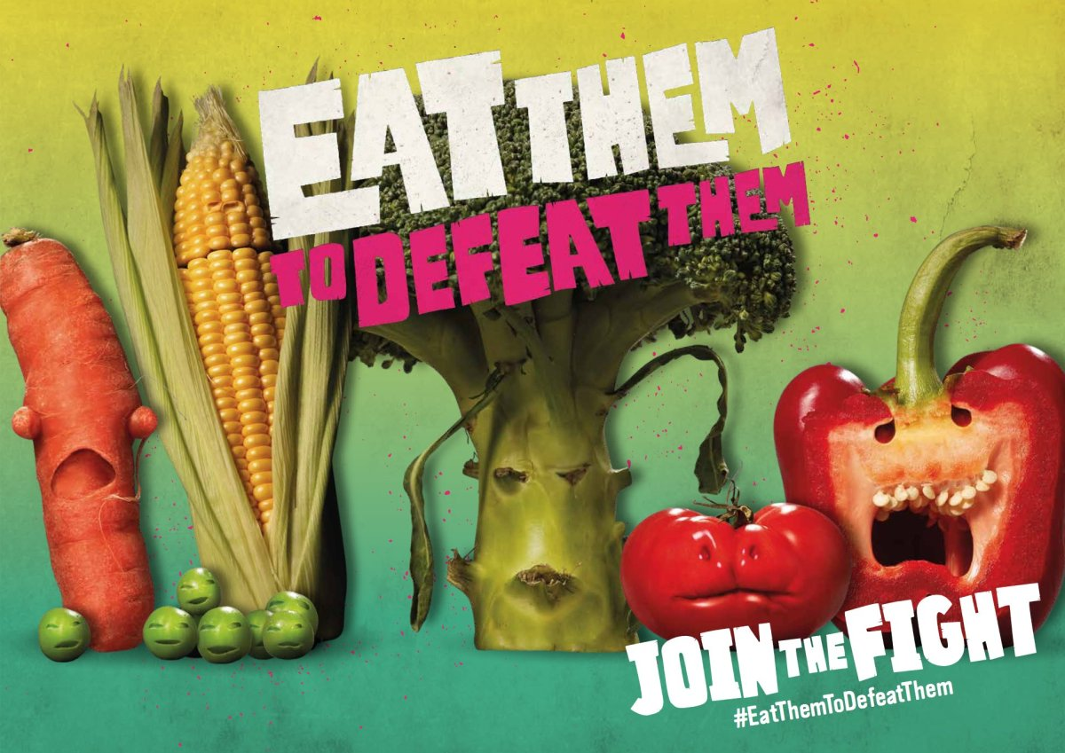 "Photo shows photo shopped vegetables with menacing mouths. It says ""eat them to defeat them"" in large text across the vegetables."